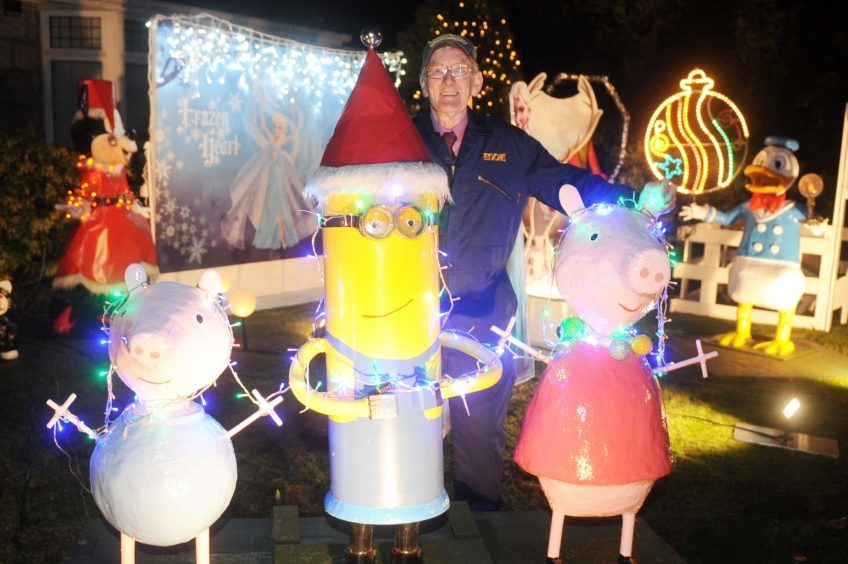 Eddie Stevenson of Ashgrove Road West who lights up his garden every year for Christmas with donations to charity. Pic by Chris Sumner