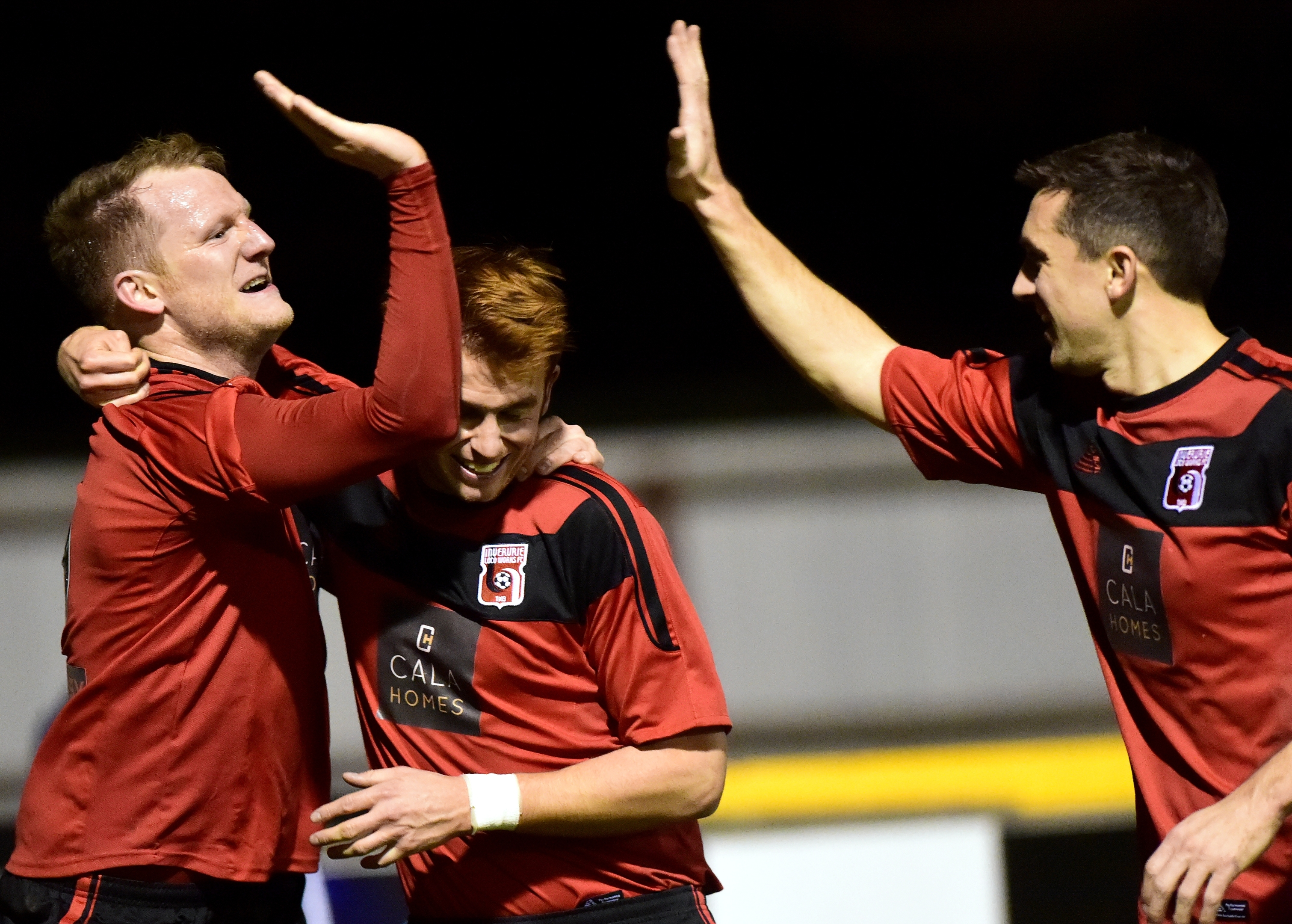 Loco's Ross Anderson (left) celebrates his goal  with Martin Laing and Neil McLean (right).