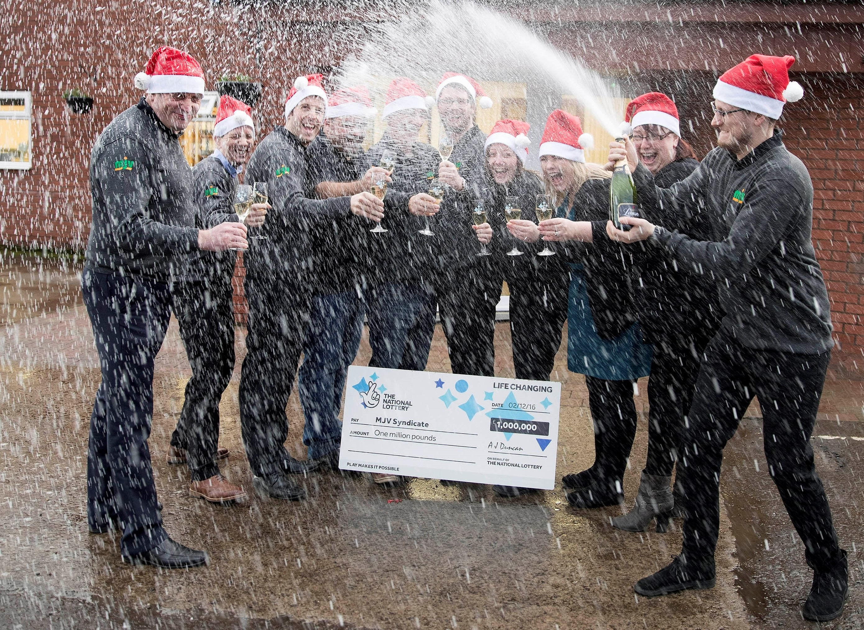 From left to right: Graeme Lacey, Bruce Richards, Darren Graham, Gareth Dack, John Cunningham, Philip Souter, Colleen Mallis, Louise Robertson, Gail Brown and Stephen Robertson, some of the 16 ventilation workers who won £1 million in a lottery syndicate.