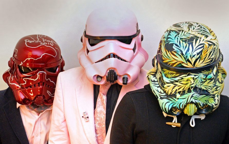 Stormtrooper helmets by (L-R) Sir Anish Kapoor entitled 'Untitled', Ben Moore entitled 'Pink StormTrooper, and Carne Griffiths entitled 'A Force of Nature',