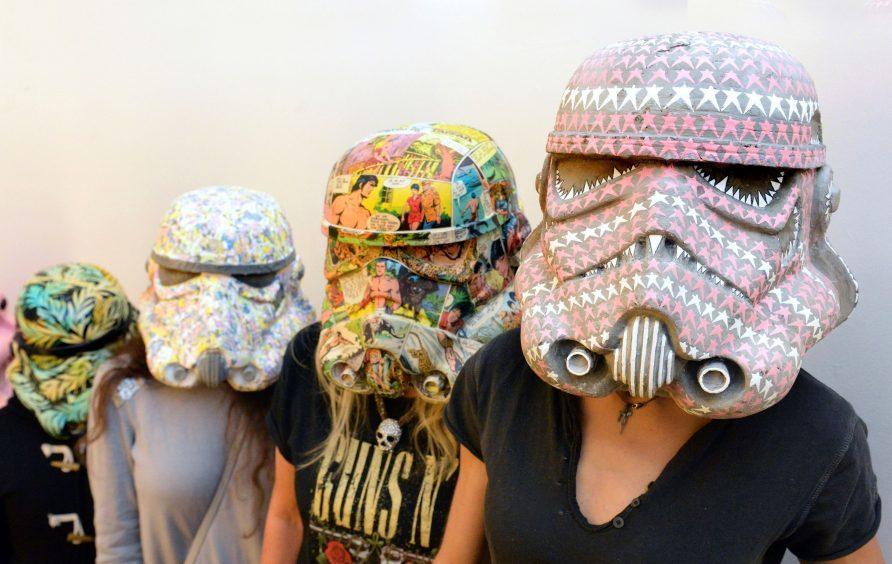 Stormtrooper helmets by (L-R) Carne Griffiths entitled 'A Force of Nature', Agnetha Sjogren entitled 'Law of the Jungle', Polina Vasenkova and Miranda Donovon entitled 'Rocket Fairy',