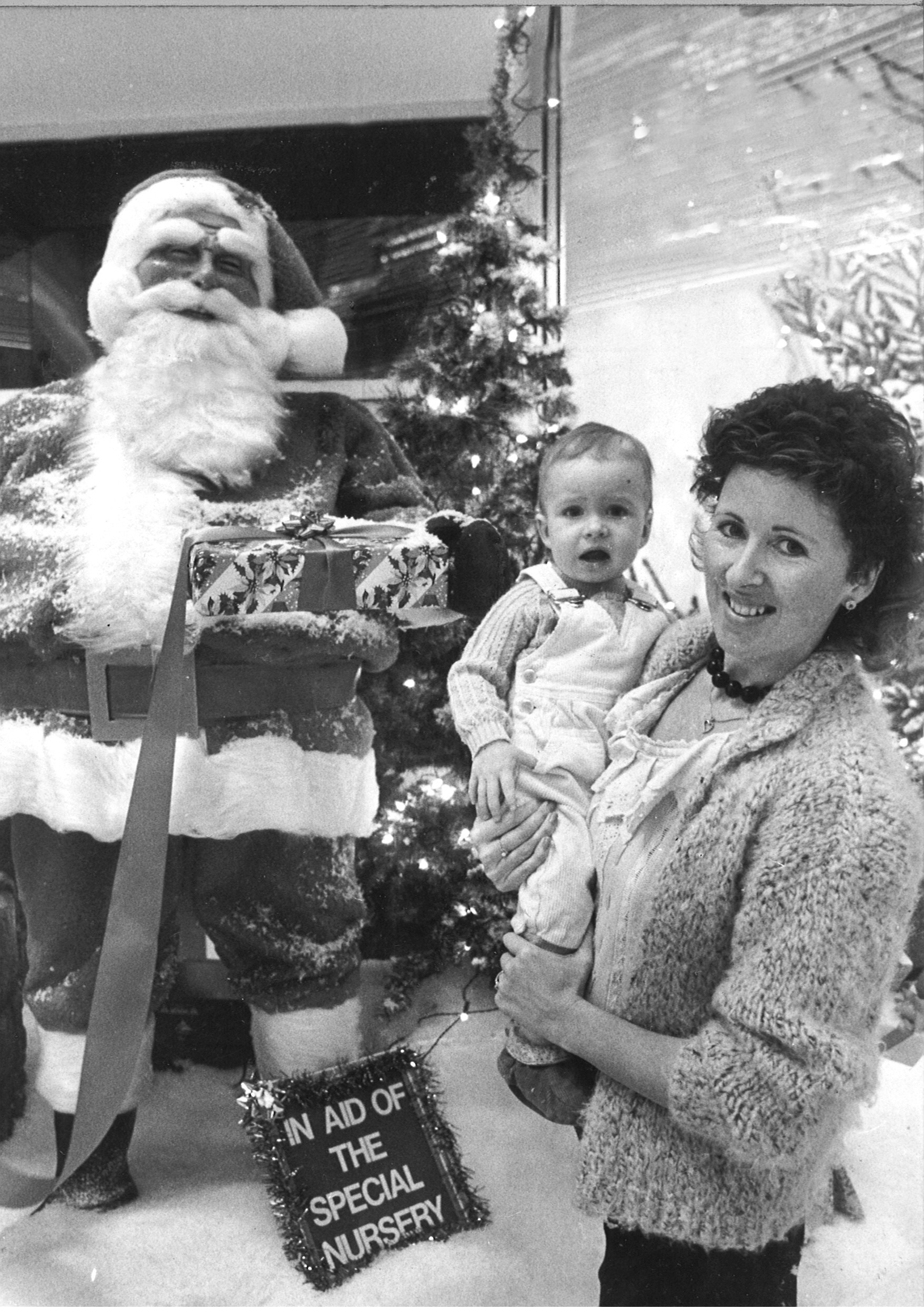 One year old Nathan Foyil of Newtonhill with 'Santa' and mum Marion