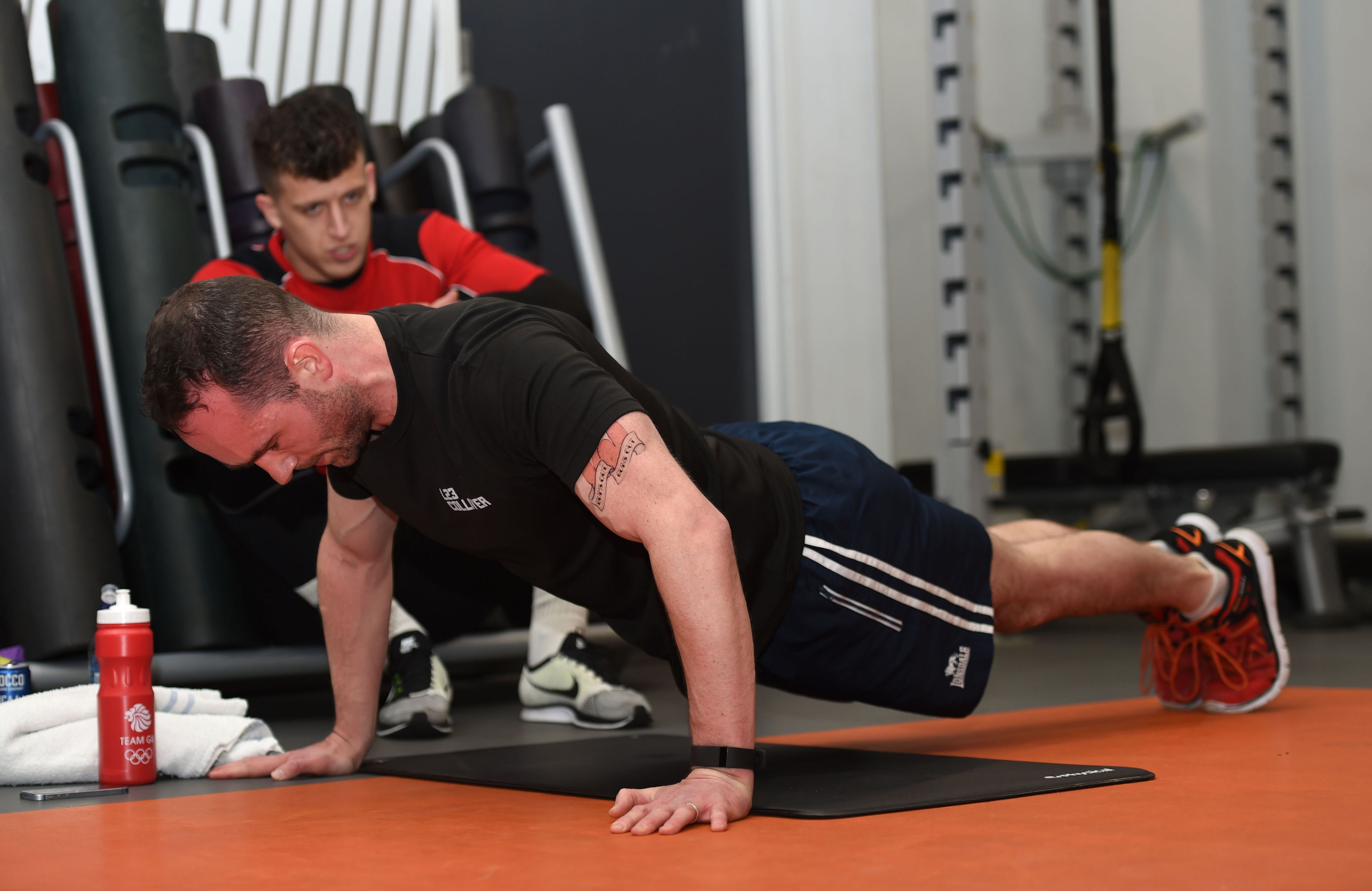 Ed Corrie, from the Bums Out Guns Out campaign group, during an attempt to break the press-ups world record at Oxford Circus Fitness First, London.