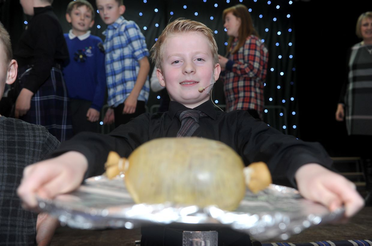 New Elgin Primary School pupil Jack Granitza gave a lively address to the haggis.