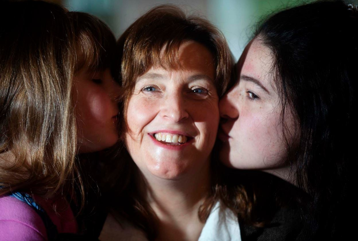 Doreen McClelland-Jones with daughters Siena, left, and Alina, right, has no doubts she would have died if CPR was not performed on her.