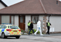 Police and forensic at a house at Peter Buchan Drive in Peterhead