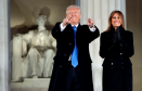 """President-elect Donald Trump, left, and his wife Melania Trump arrive to the """"Make America Great Again Welcome Concert"""" at the Lincoln Memorial"""