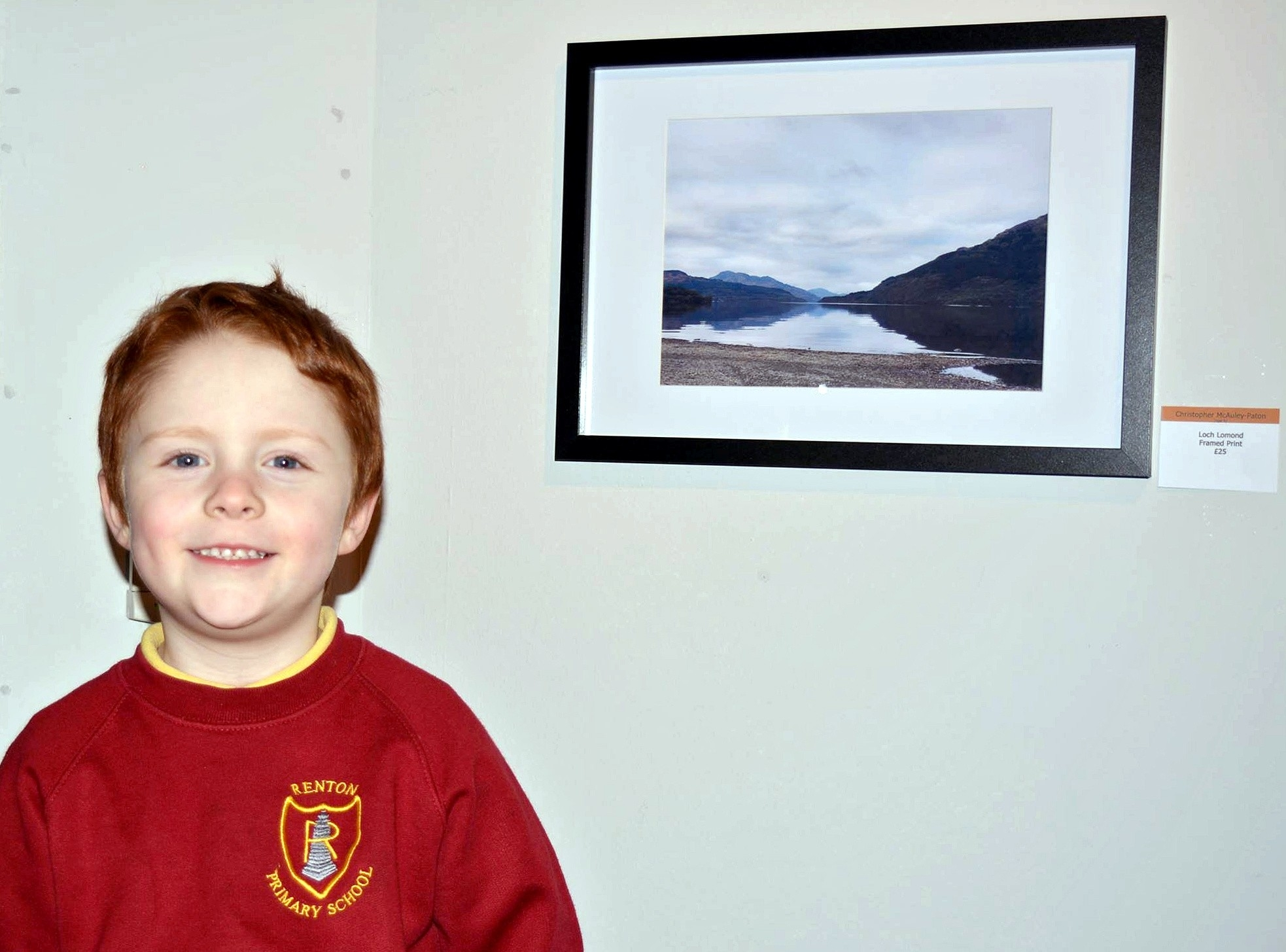 Christopher McAuley-Paton, 4, beside his photo of Loch Lomond he snapped on his mum's iPhone.