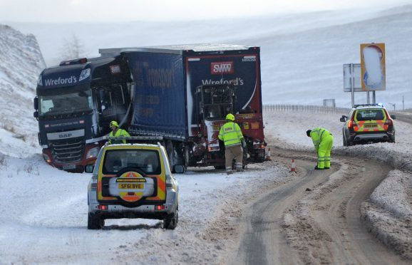 A jackknifed lorry on the A9 near the Drumochter Pass in the Scottish Highlands.