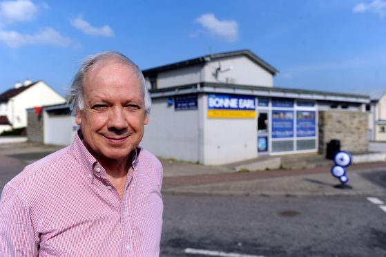 Fraser Robson, owner of the Bonnie Earl Bar and shop in Bishopmill, Elgin, outside his business premises. Picture by Gordon Lennox