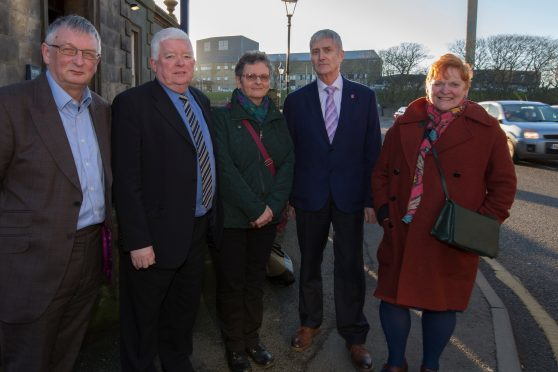 Following their private meeting in Wick are, from left, David Alston, chairman NHS Highland, Councillor Bill Fernie, chairman of CHAT Liz More, CHAT member, Councilor Roger Saxon, chairman Highland Council's Caithness area committee and Councillor Margaret Davidson, convenor of Highland Council, with Caithness General Hospital in the background.