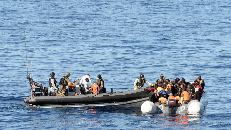 A Royal Navy crew assisting a boat of migrants in the Mediterranean (MoD/PA)