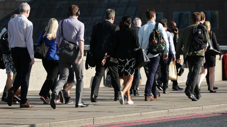 City workers walking along London Bridge before the pandemic.