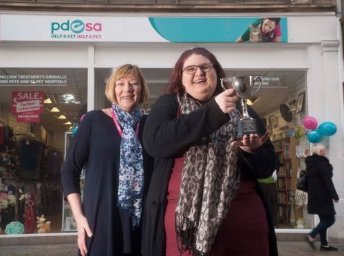 PDSA young volunteer of the year Lani Watson with Sheila Landers, who has volunteered for the charity for 15 years, outside the organisation's shop on Elgin's high street.