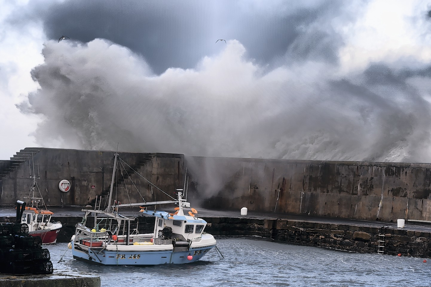 Huge waves at Portsoy harbour. Picture: Kenny Elrick.