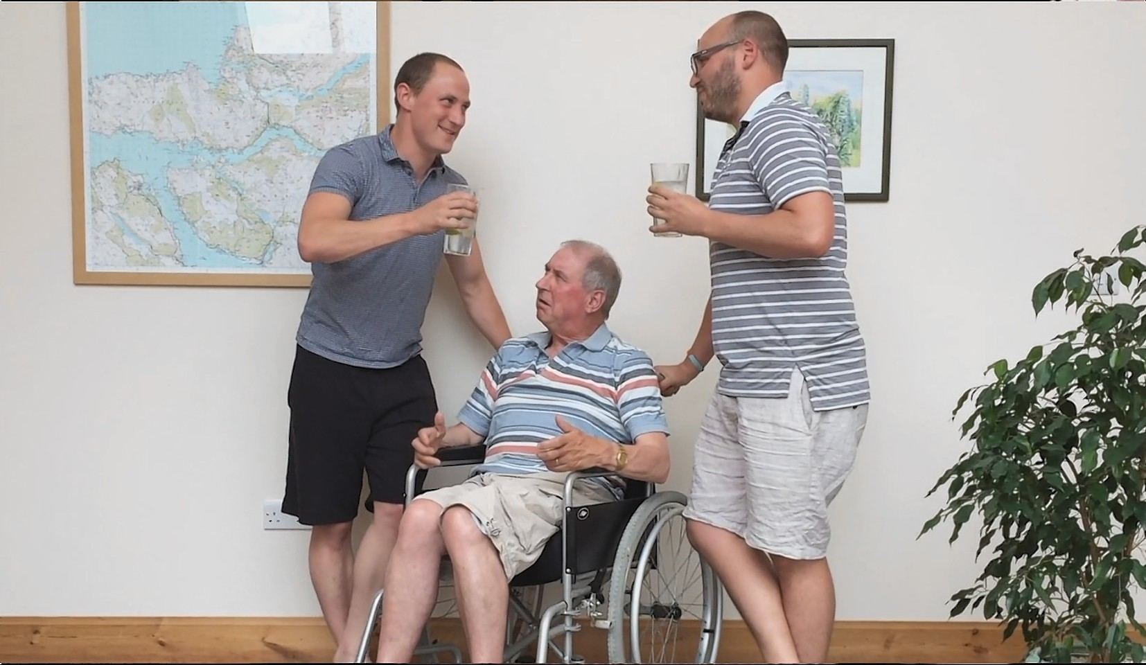 Stephen with sons, Duncan and Angus in one of the videos.