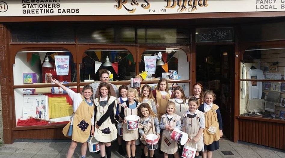 Last year's cast of Annie fundraising in Fraserburgh