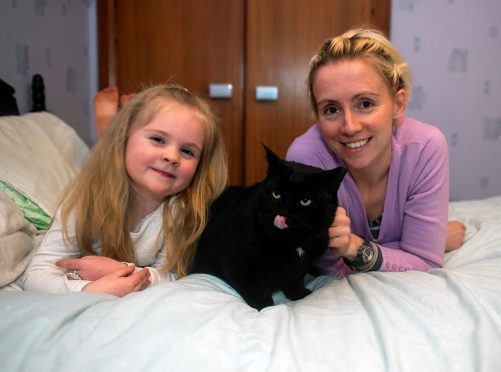 Vet Bethan Fitzgerald with daughter Eira and cat Sam.