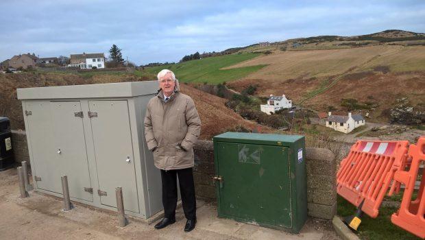 Councillor Ian Mollison stands next to the huge eyesore overlooking Newtonhill Bay