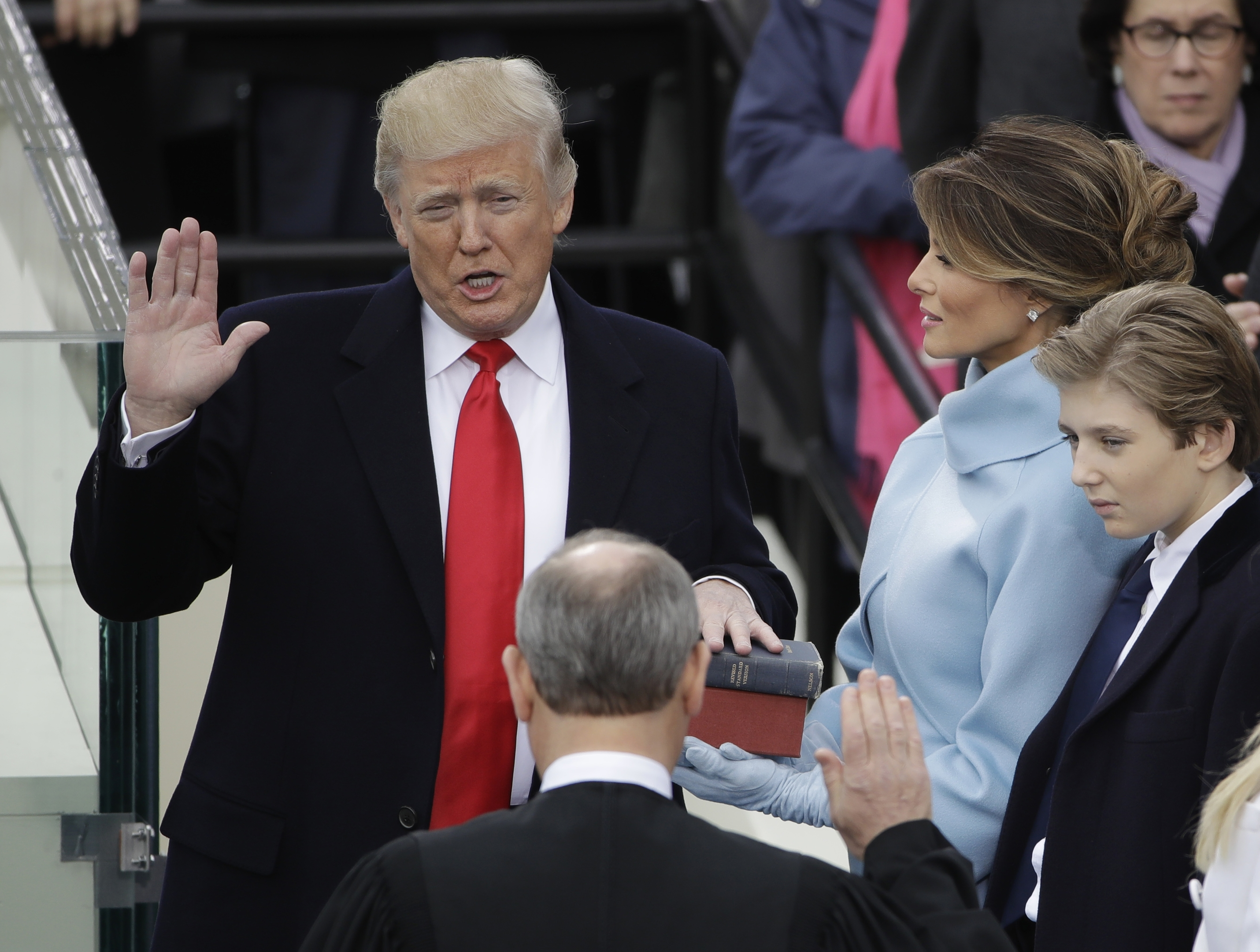 Donald Trump is sworn in as the 45th president of the United States by Chief Justice John Roberts as Melania Trump looks on during the 58th Presidential Inauguration at the U.S.