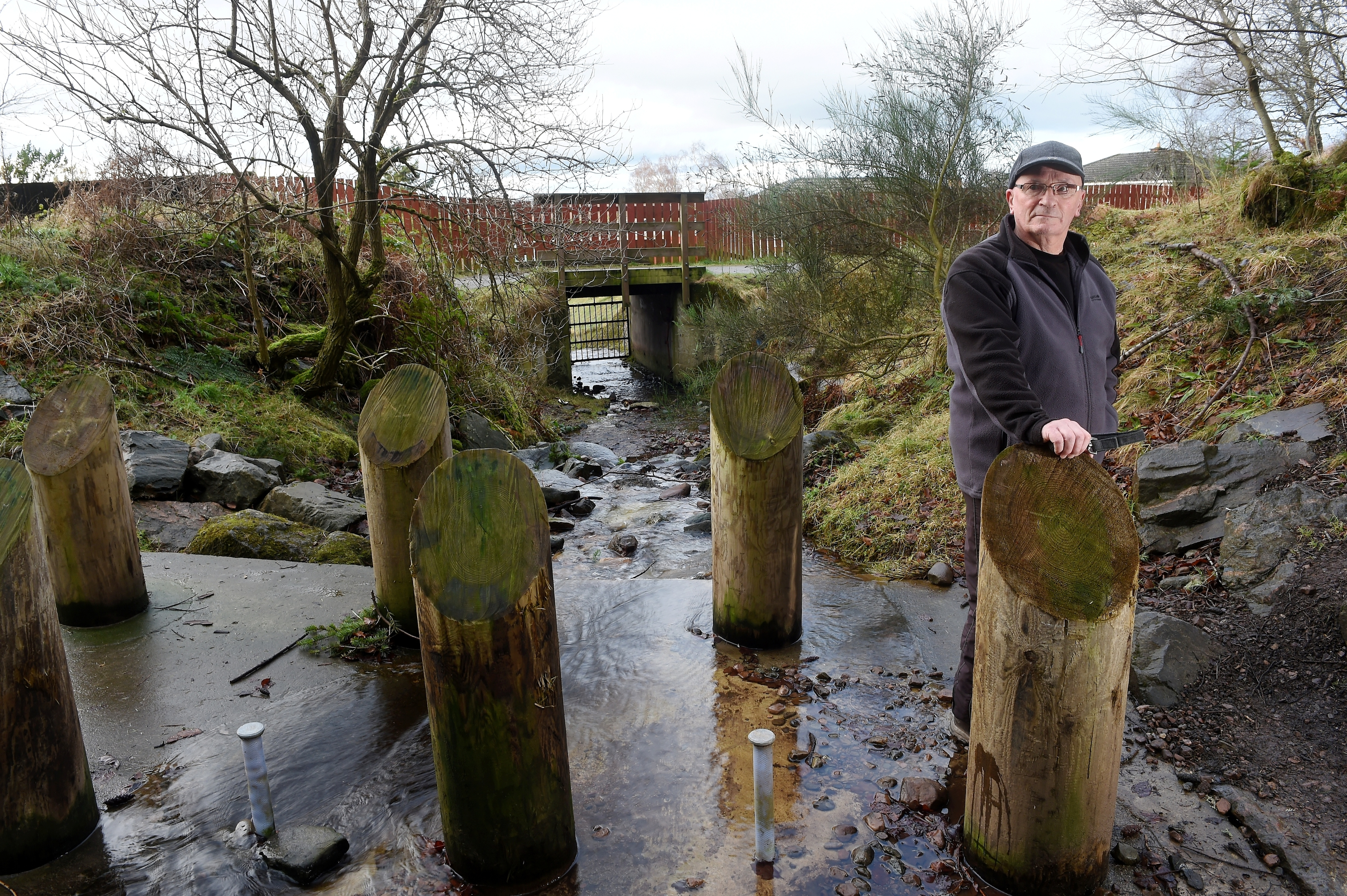 Alex Nicol of Culloden beside the flood defences on a burn through the village which he claims are inadequate.