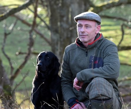 Peter Littlejohn, head wildlife ranger with Jack the Labrador.   Pictures by Jim Irvine.