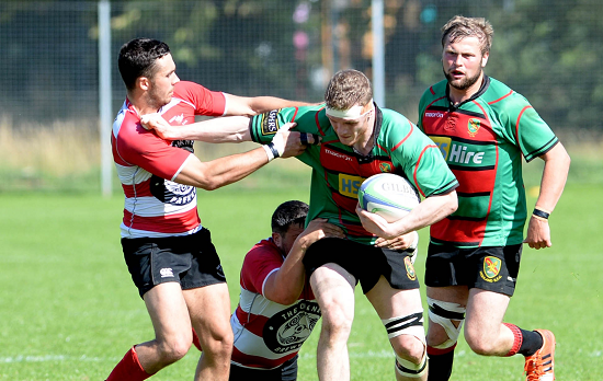 Orkney's William Thomson (left) and Philip Ross try to stop Highland's Andrew Findlater