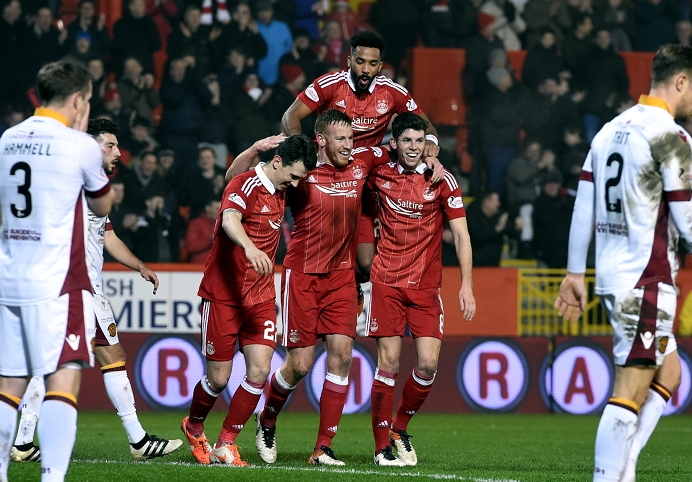 Pictured is Aberdeen's Adam Rooney celebrating scoring the third goal of the game