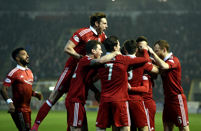 Pictured is Aberdeen players celebrating Jonny Hayes opening the scoring