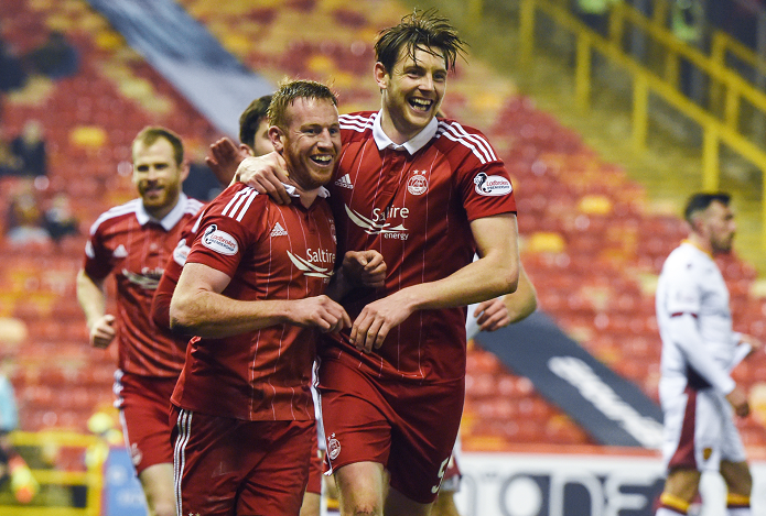 Aberdeen's Adam Rooney completes his hat-trick and celebrates with Ash Taylor (R)