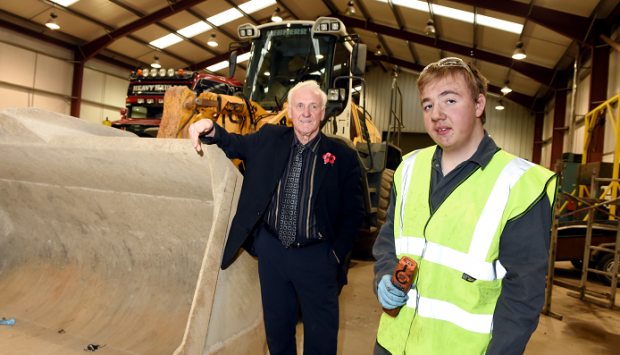 Bert McIntosh owner of McIntosh Plant Hire (Aberdeen) Limited, with their apprentice John Bruce (16) from Peterhead at their workshop at Birchmoss Plant & Storage Depot.          Picture by KEVIN EMSLIE