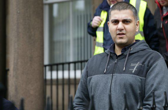 Mohammed Aslam leaves court in custody.