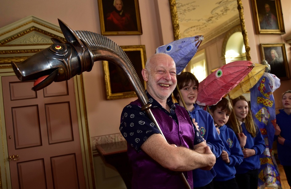 Musician John Kenny with a replica of the Deskford Carnyx and pupils from Banff Academy