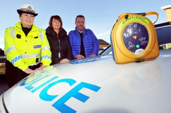 Chief inspector Louise Blakelock with Sandra and Gordon McKandie at the launch of the pilot scheme for defibrillators to be carried in the boot of road policing vehicles.