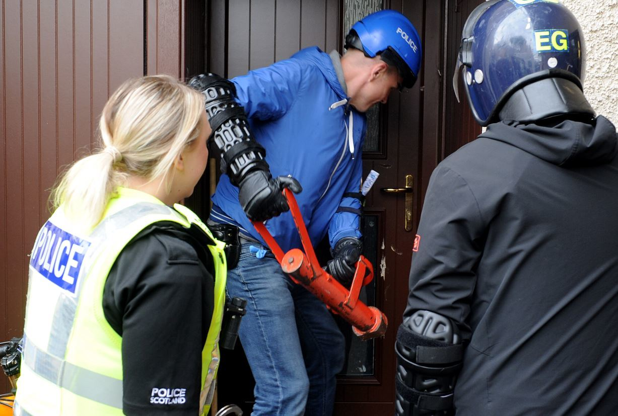 Police force entry to an Elgin home in a dawn drugs raid.