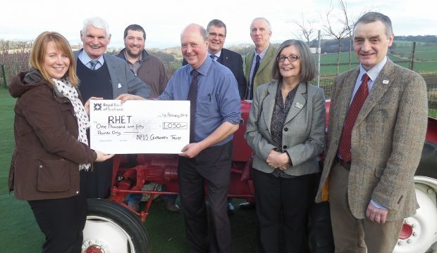 Katina Barclay from RHET being presented with a cheque from NFU Scotland's Centenary Trust as it met for the final time.