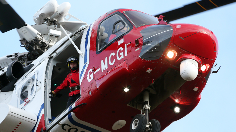 A coastguard helicopter is involved in the rescue effort