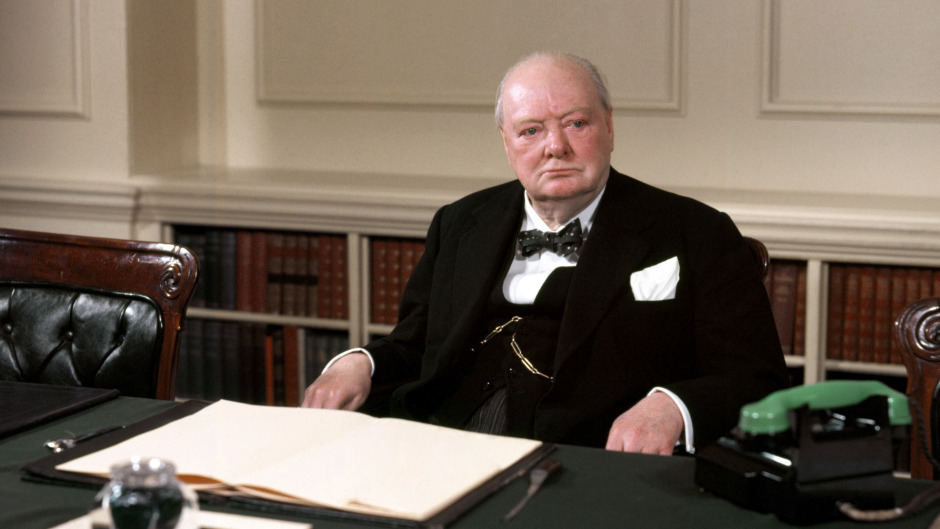 Winston Churchill in the cabinet room at 10 Downing Street- a new essay has revealed his thoughts about the possibility of alien life
