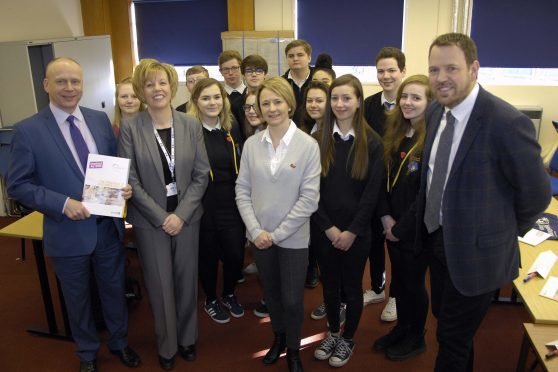 Willie Wood HR Director of Johnstons and chair of DYW Moray; Moira Stickle manager DYW Moray; Gail Cleaver retail sales and operations manager and Simon Cotton, chief executive Johnstons of Elgin with pupils from Lossiemouth High School.