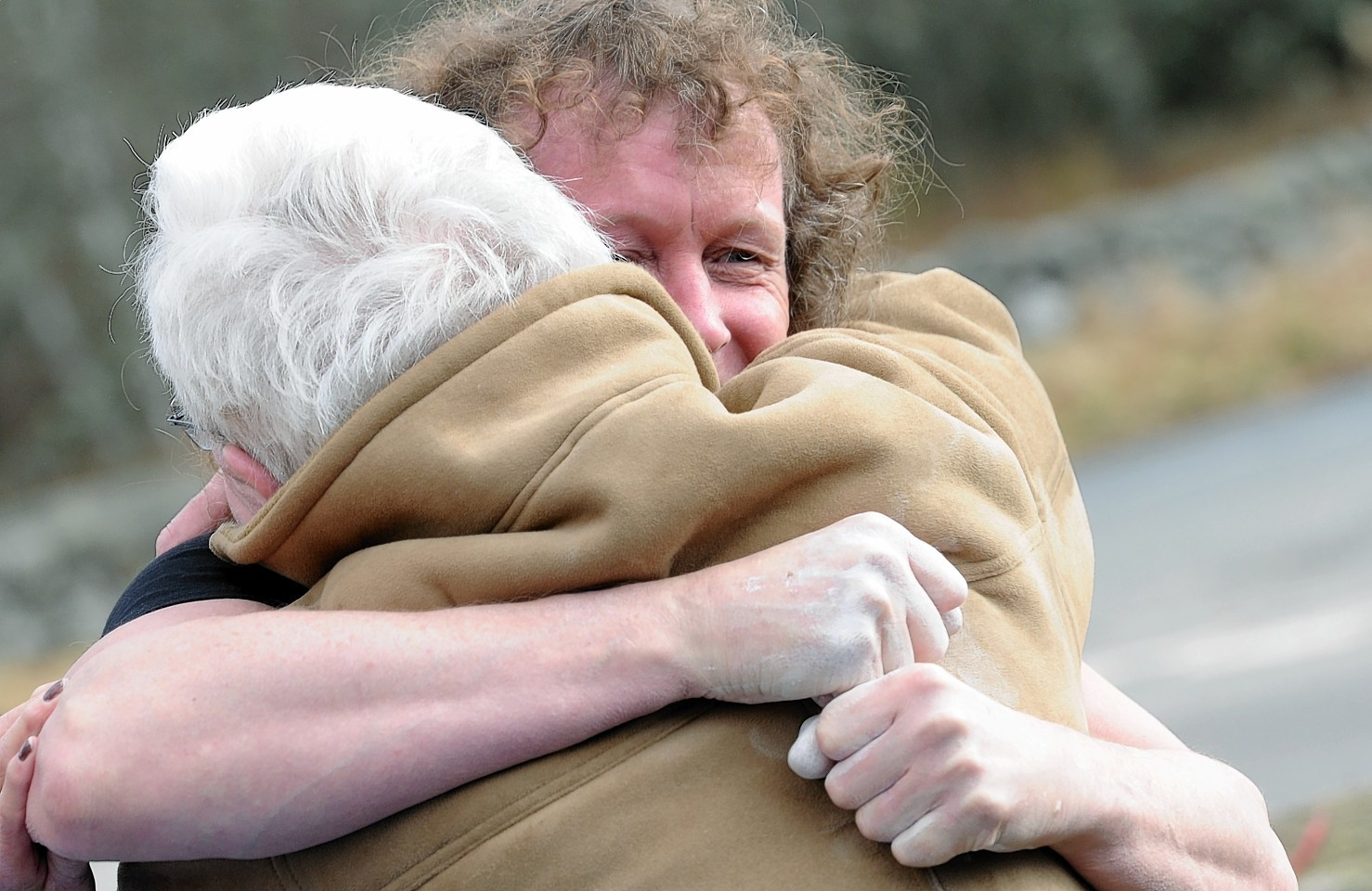 Stevie Shanks embraces his father, Jack Shanks, after his successful lift at Potarch. Credit: Colin Rennie.