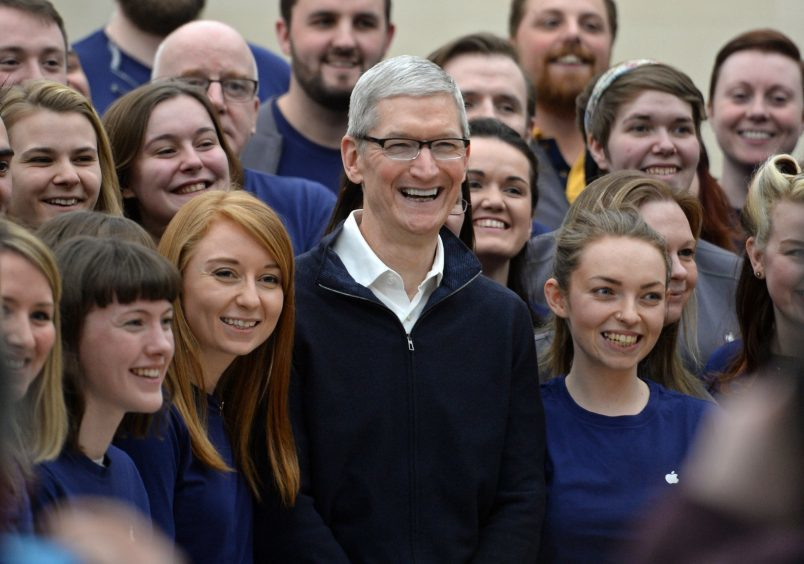 Apple CEO Tim Cook arrives in Glasgow where he surprised customers in the the city centre's Apple store before he is due to pick up an honourary degree from the University of Glasgow. .