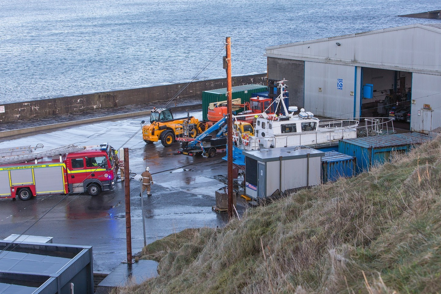 Firefighters at the warehouse at Wick Harbour