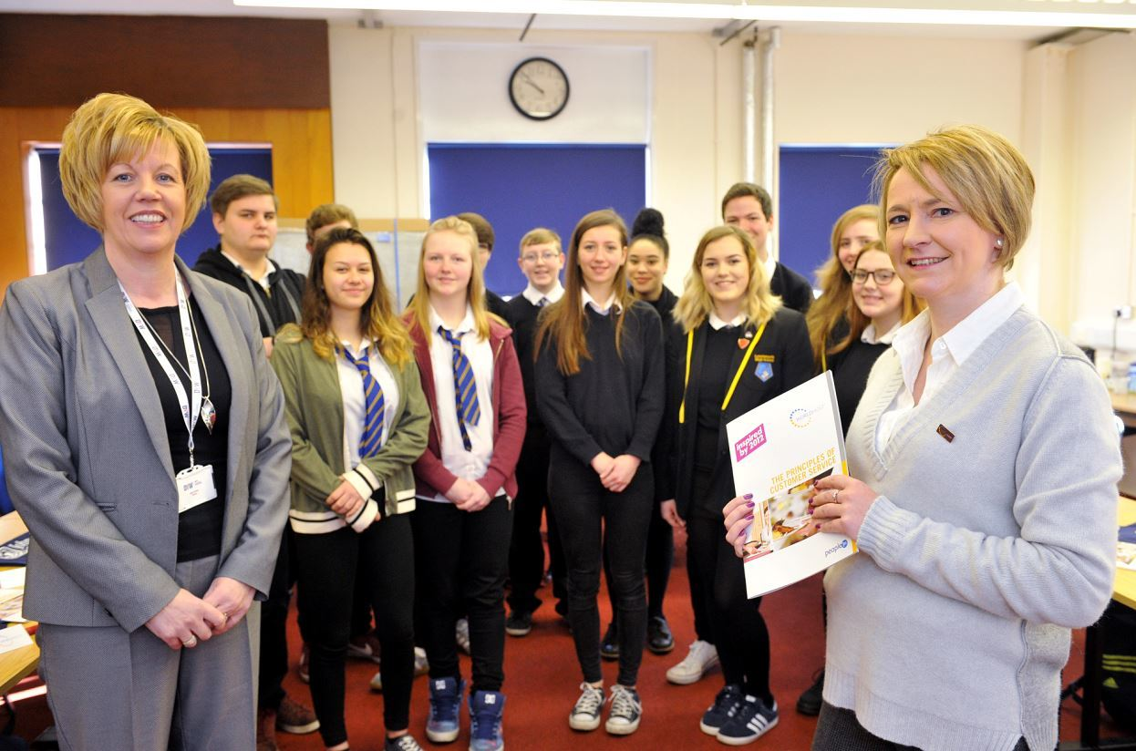 Lossiemouth High School pupils prepare for their World Host training with Moira Stickle, DYW manager for Moray, left, and Gail Cleaver, Johnstons of Elgin operations manager, right.
