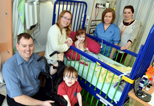 The charity Charlie House has employed their first permanent nurse. Jackie Stewart is pictured (second right) with (from left) Dave Bruce, Charlotte, children Findlay, Iona, and Charlie House's Sorcha Hume (right).