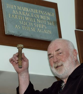 """First piece of the tea clipper """"Cutty Sark"""" to come back home to Inverbervie and Scotland, an original bolt from the hull is proudly held by Dave Ramsay in the Burgh  Hall Inverbervie beside the Hercules Linton Memorial."""