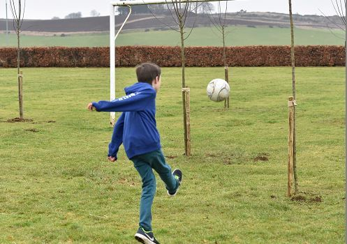One pupil scores on the newly planted football pitch at Logie Durno