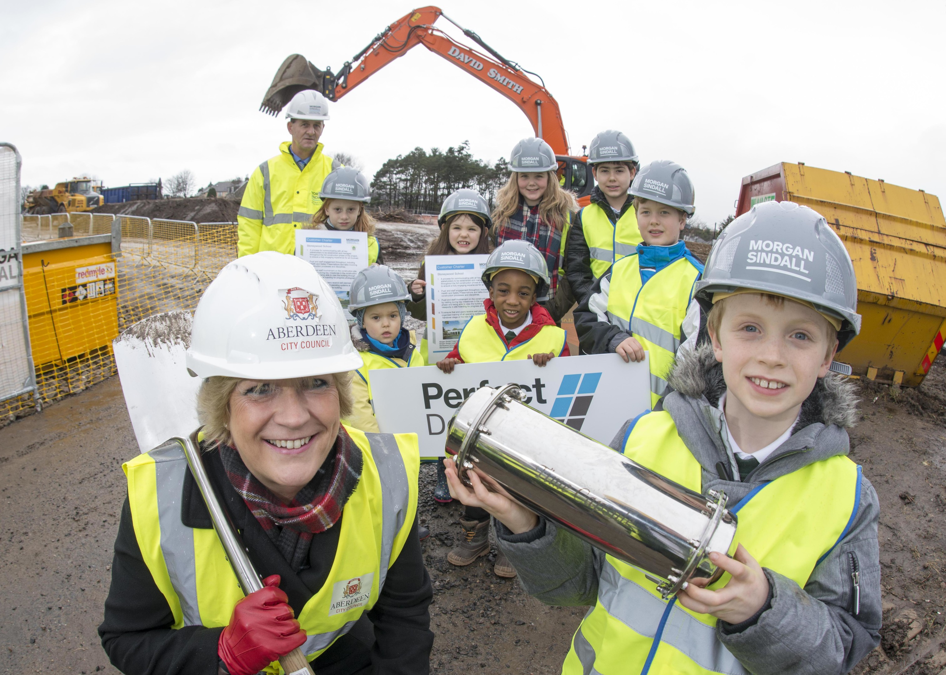 23/02/17 Ben Morrice ( 8YO pr3 ) with a time capsule with Councillor Angela Taylor with- Geoff Burton, Project Manager for Morgan Sindall and pupils from Stoneywood primarty School-  Karolina Oplatkowska (9YO pr4), Amber Cumming (6YO pr2 centre),Matilda Henderson (12 pr7 Scarf), Miron Csurilla (12 YO pr7 black jacket),  Callum Webb (10YO pr5 blue jacket), Kristian Sliga (3YO Nursery at front), Abdullah Ismail (5YO pr1) A sod-cutting ceremony will mark the official commencement of work on the new £13 million Stoneywood School. The new school, built on the site of fire-gutted Bankhead Academy will house 434 pupils attending the existing Stoneywood School as well as a nursery. The new state-of-the-art primary school is due for completion by Easter next year.