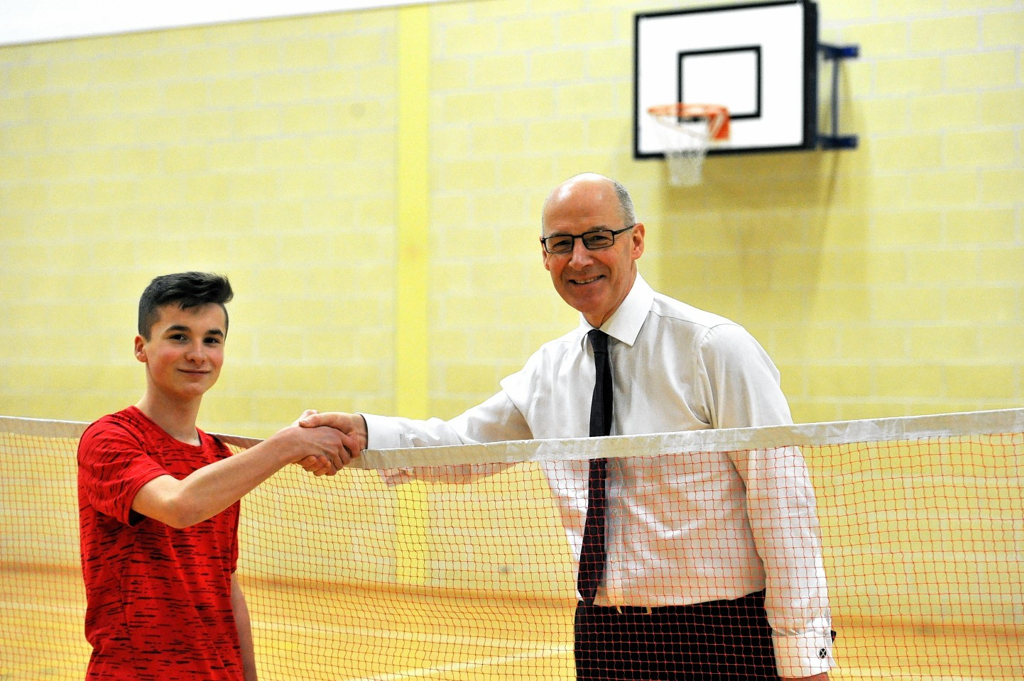 John Swinney, right, with Sean McCann, an S3 pupil who beat him in a short badminton game. Pictures by Gordon Lennox