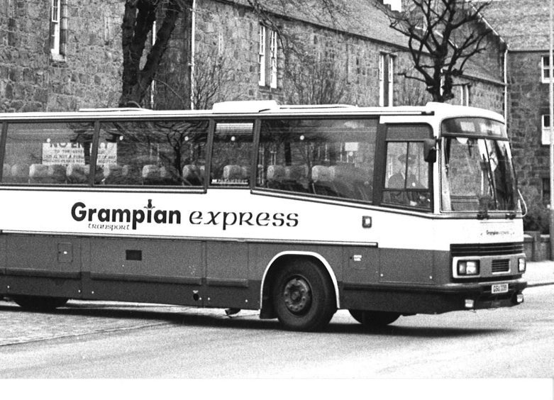 A Grampian Transport coach leaves the depot in King Street