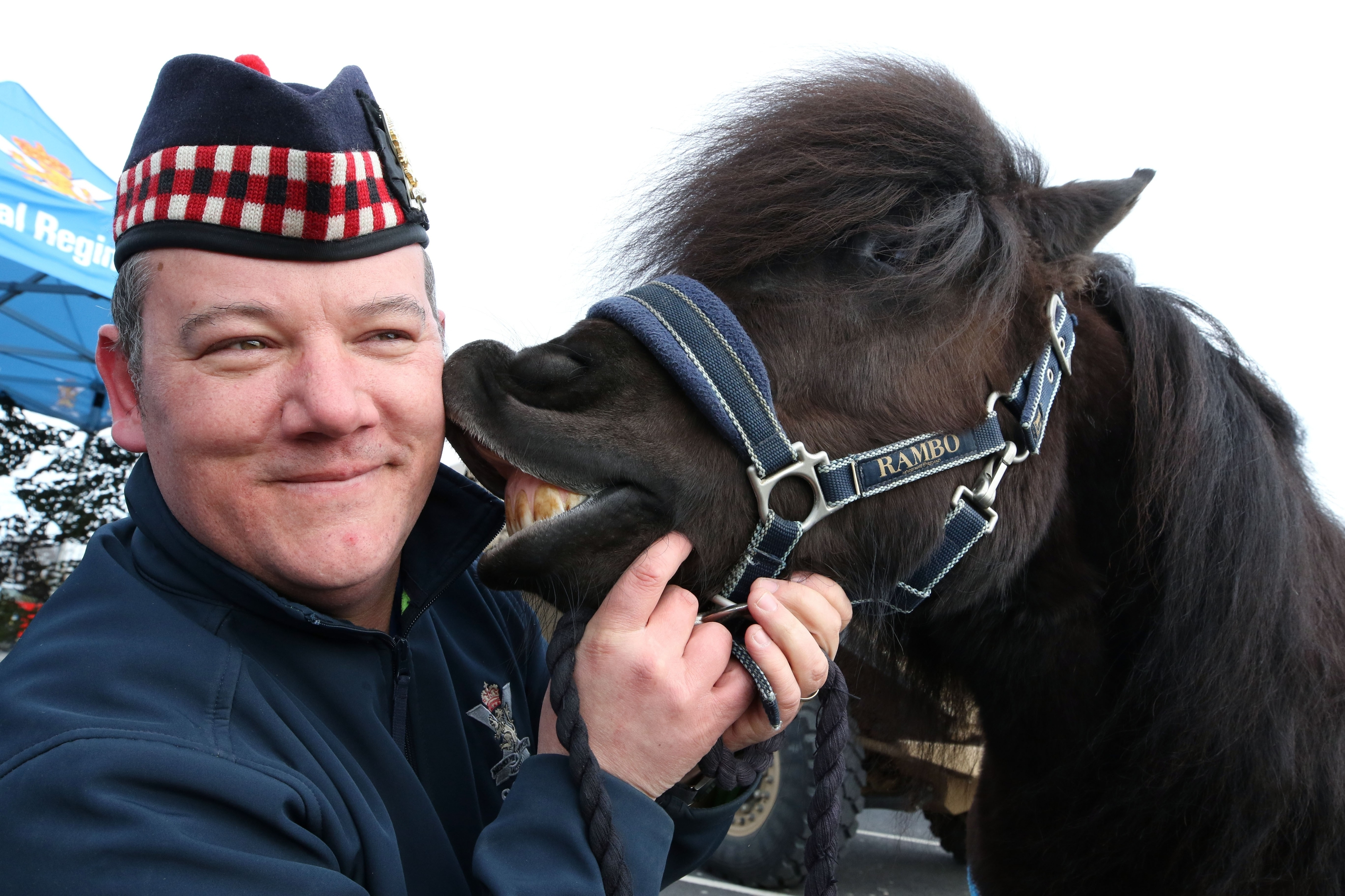 Lance Corporal Cruachan IV, the Shetland Pony mascot of the Royal Regiment Scotland, with Pony Major Mark Wilkinson at the Tesco store in the Eastfield retail park, Inverness